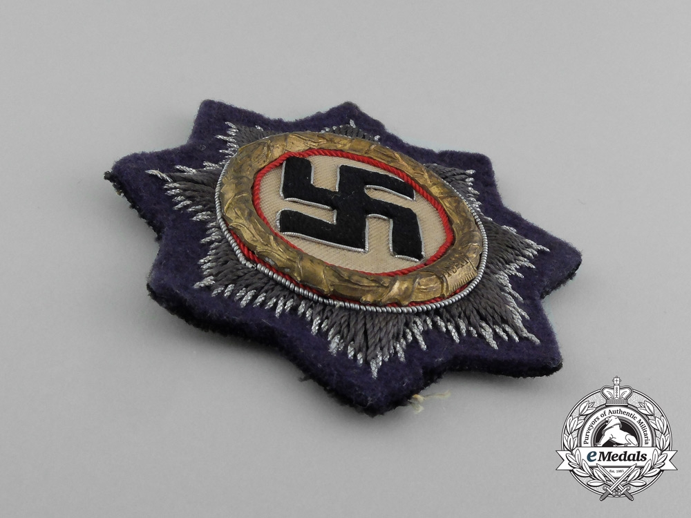 Germany, Kriegsmarine. A German Cross in Gold, Cloth Version by C. E. Juncker