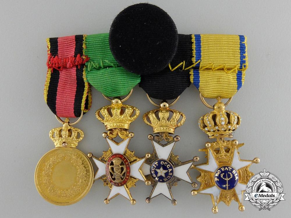 A Fine Miniature Swedish Miniature Group in Gold