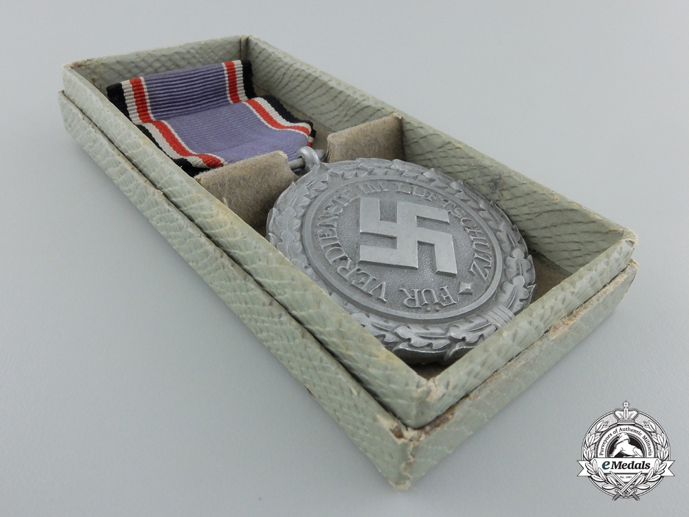 An Air Defence (Luftschutz) Medal; Second Class with Box of Issue