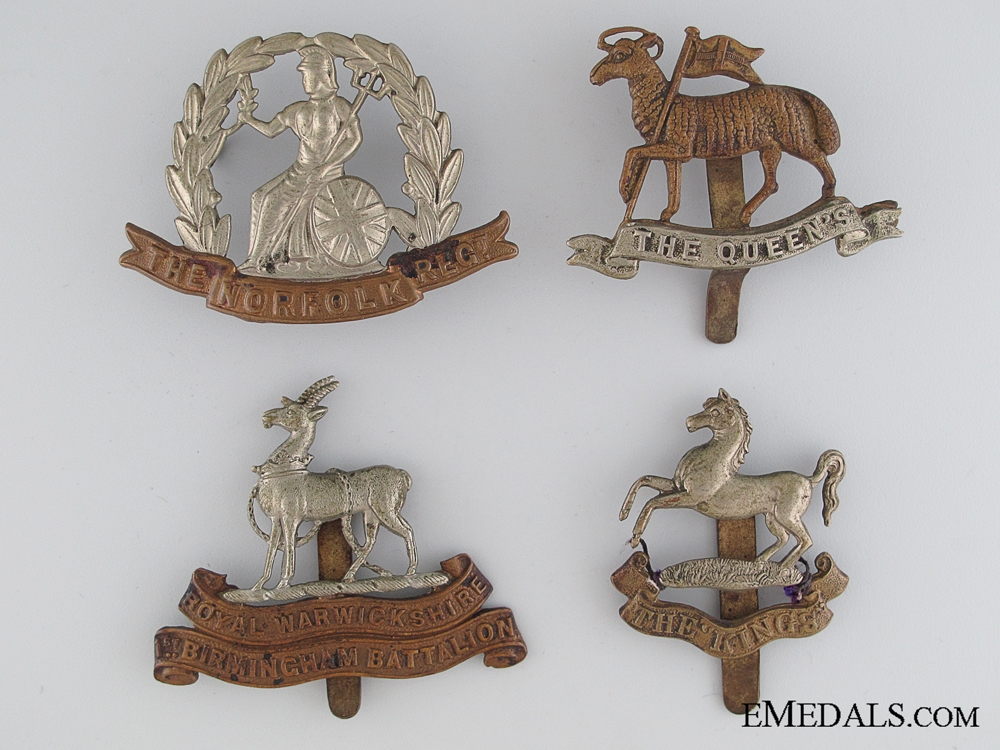 Four WWI British Regimental Cap Badges