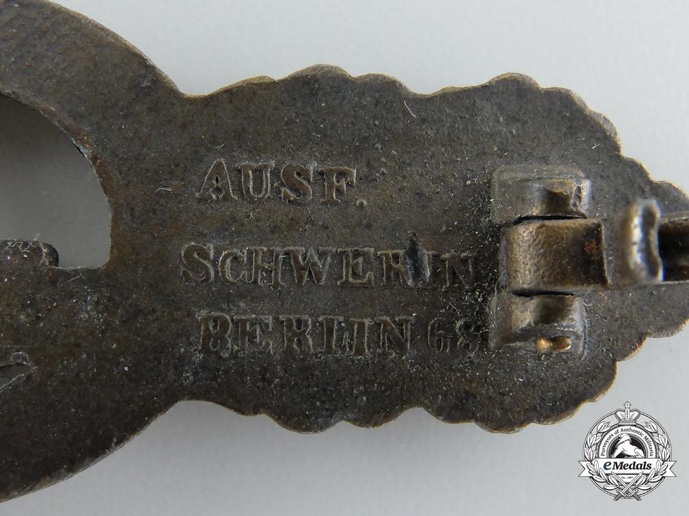 A Kriegsmarine Submarine Clasp; Bronze Grade by Schwerin