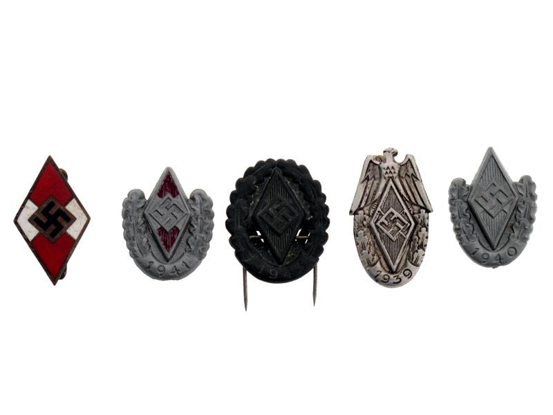 Five HJ Tinnies/badges,