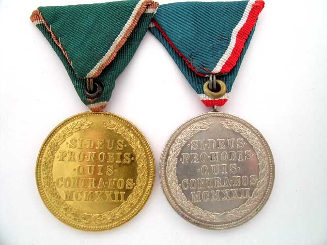 TWO MEDALS OF MERIT