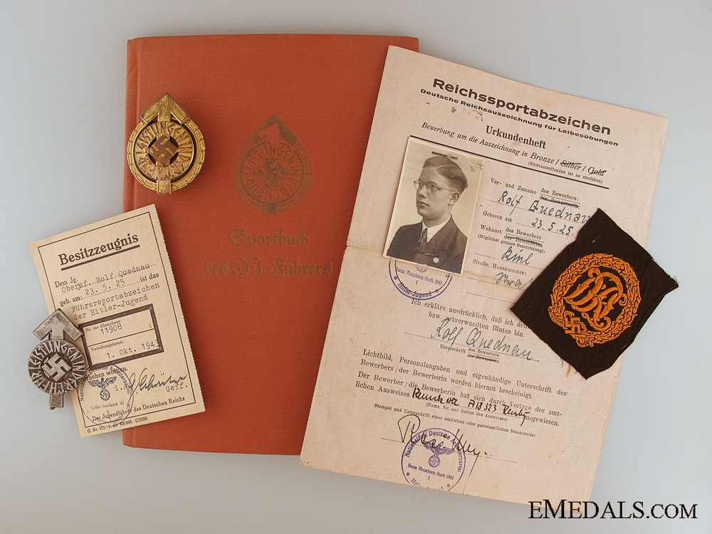 A HJ Golden Leader's Sports Badge with Award Documents