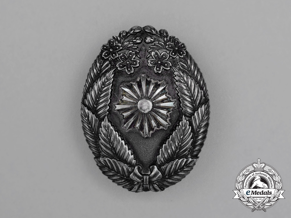 Japan, Imperial. A Fire Brigade Merit Badge in Silver
