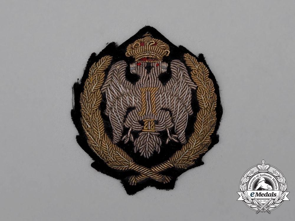 """A Yugoslav Artillery Officer's Visor Insignia; """"British"""" Cap Version"""