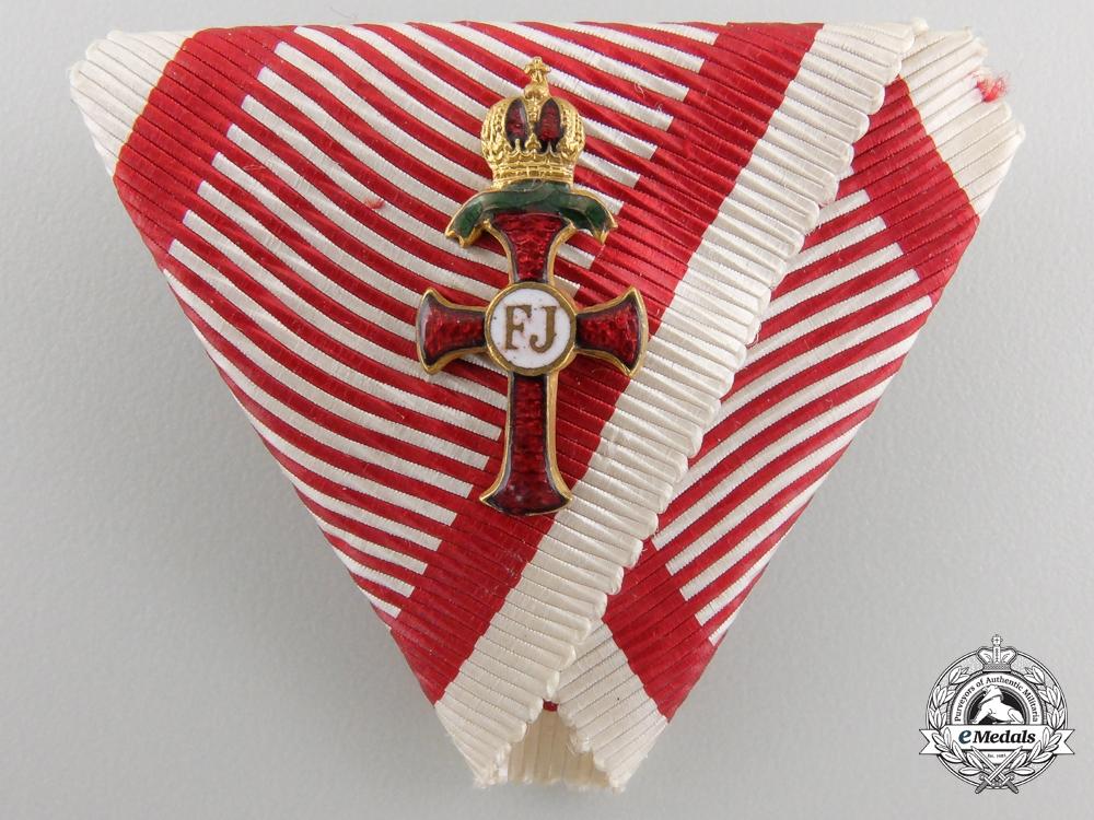 An Austrian Order of Franz Joseph; Officer Miniature on War Decoration Ribbon