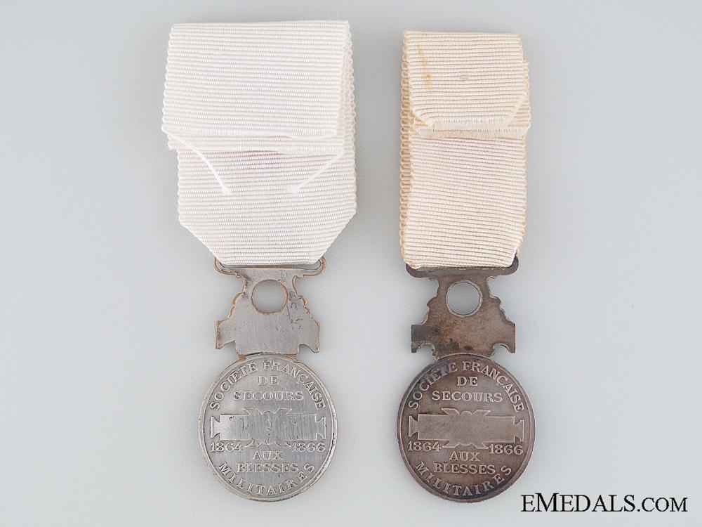 Two 1864 Société de Secours aux Blessés Militaires Medals