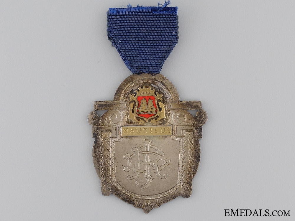 A 1945 Merchant Marine Fourth Class Engineer Medal & Document