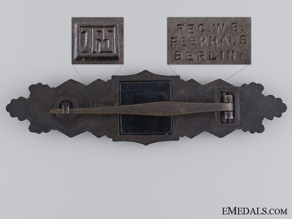 A Close Combat Clasp; Bronze by Maker JFS