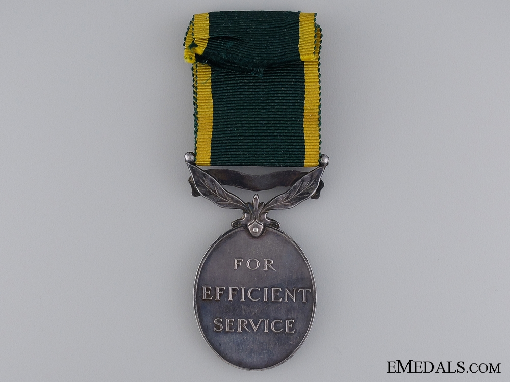 An Efficiency Medal to Acting Band Sergeant Galloway