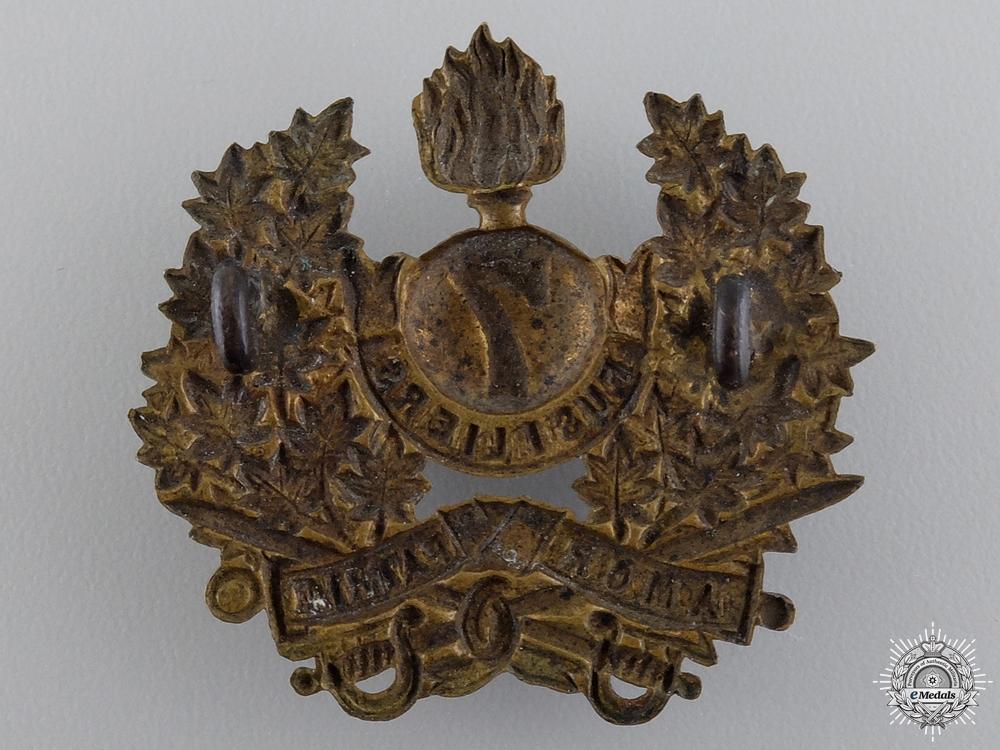 A Pre First War 7th Fusiliers Cap Badge