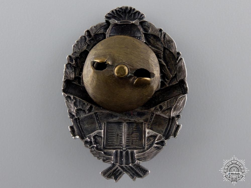A 1910-45 Bulgarian Artillery Inspectors Badge in Silver