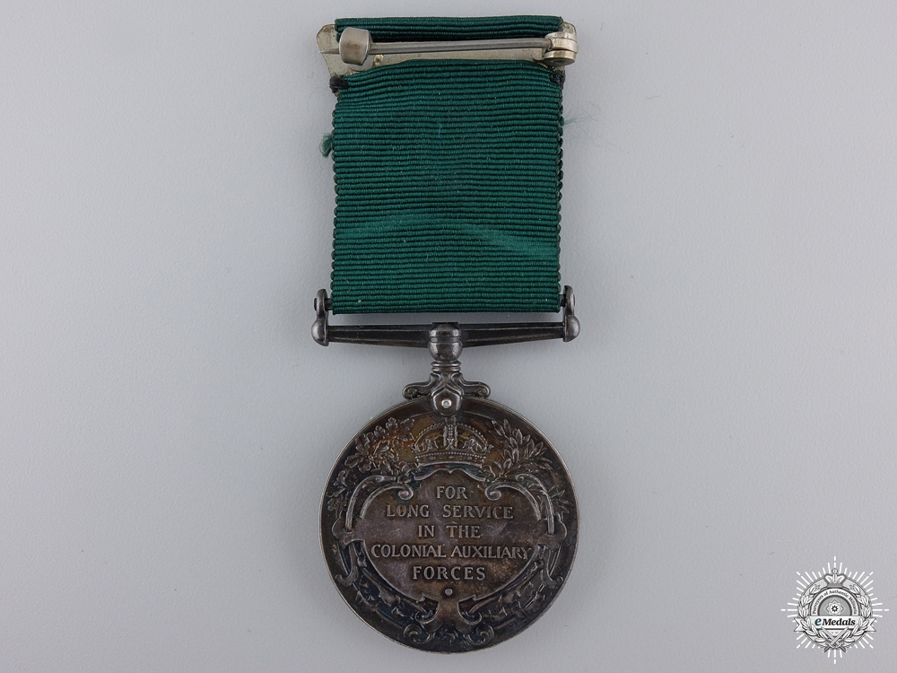 A Colonial Auxiliary Forces Long Service Medal to Major Ogden