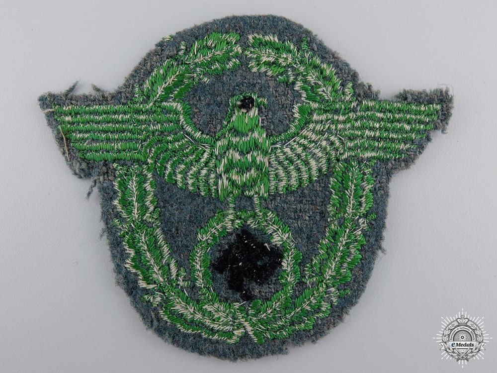 A Uniform Removed Field Police Arm Badge