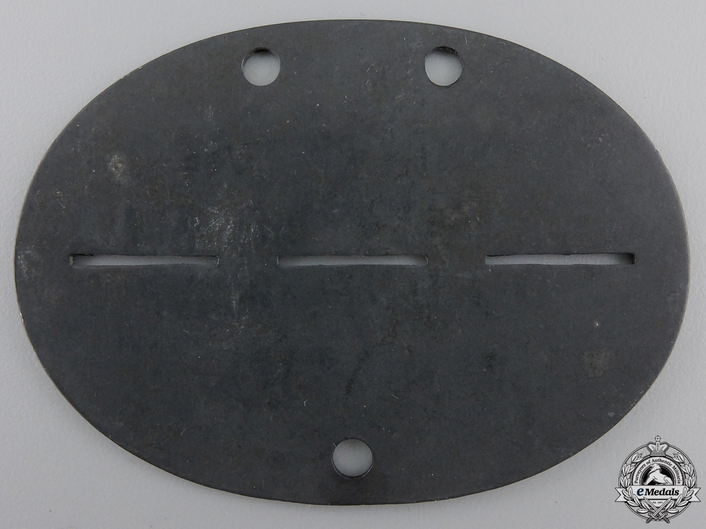 A Luftwaffe Stalag Guard's ID Disc