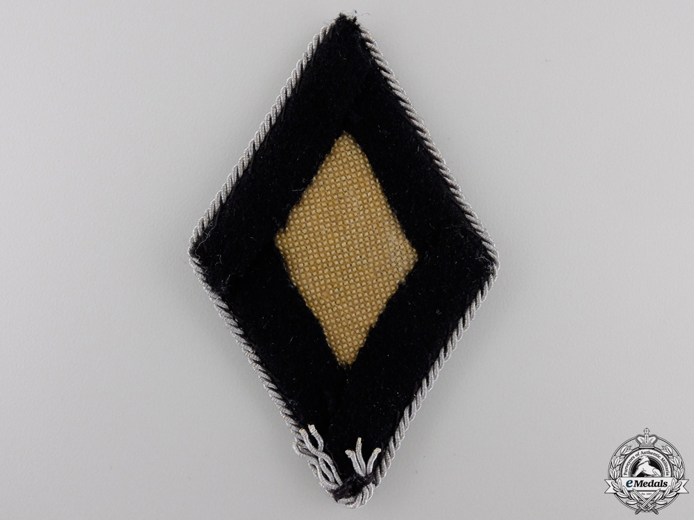 An SS – SD Officer's Sleeve Diamond Insignia