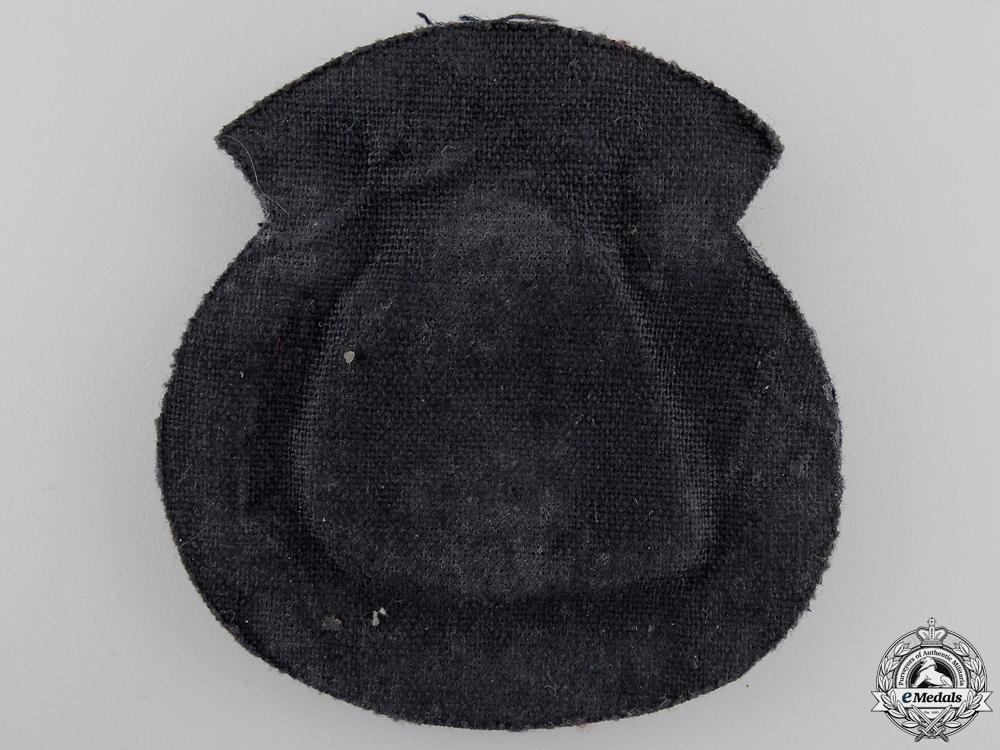 A Merchant Marine Officer's Cap Badge