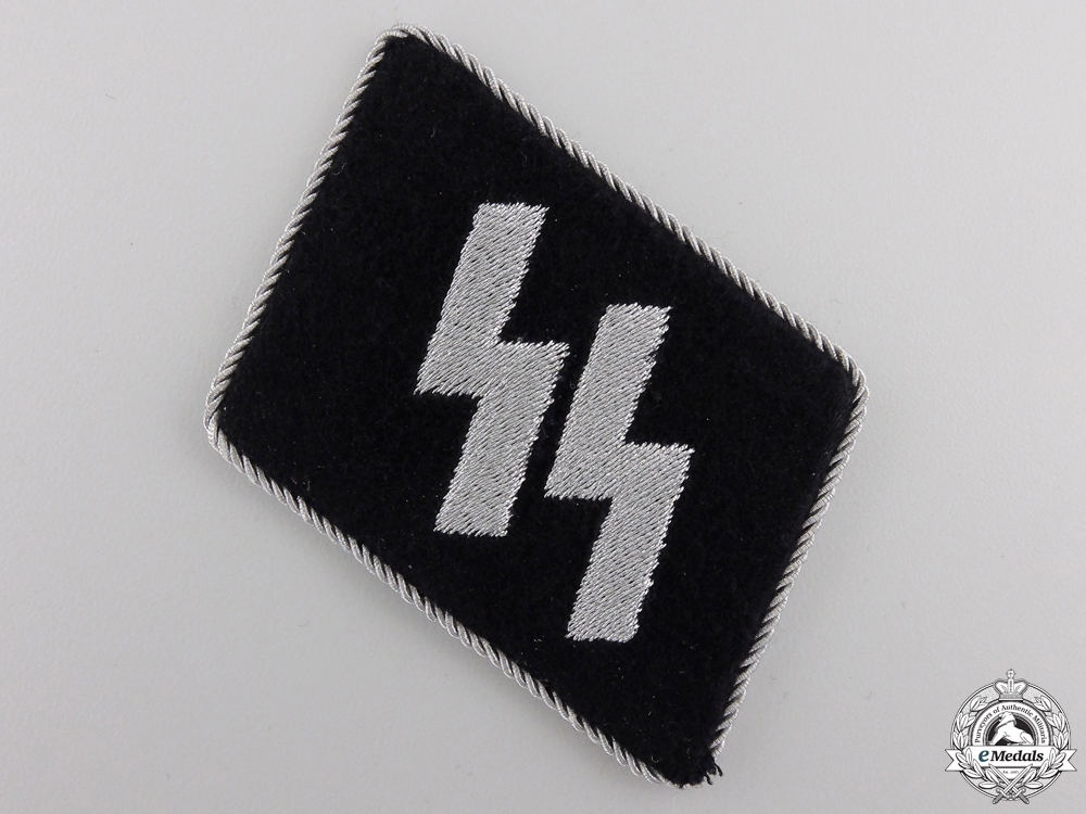 An Officer's SS Collar Tab and Dachau Clothing Work Factory