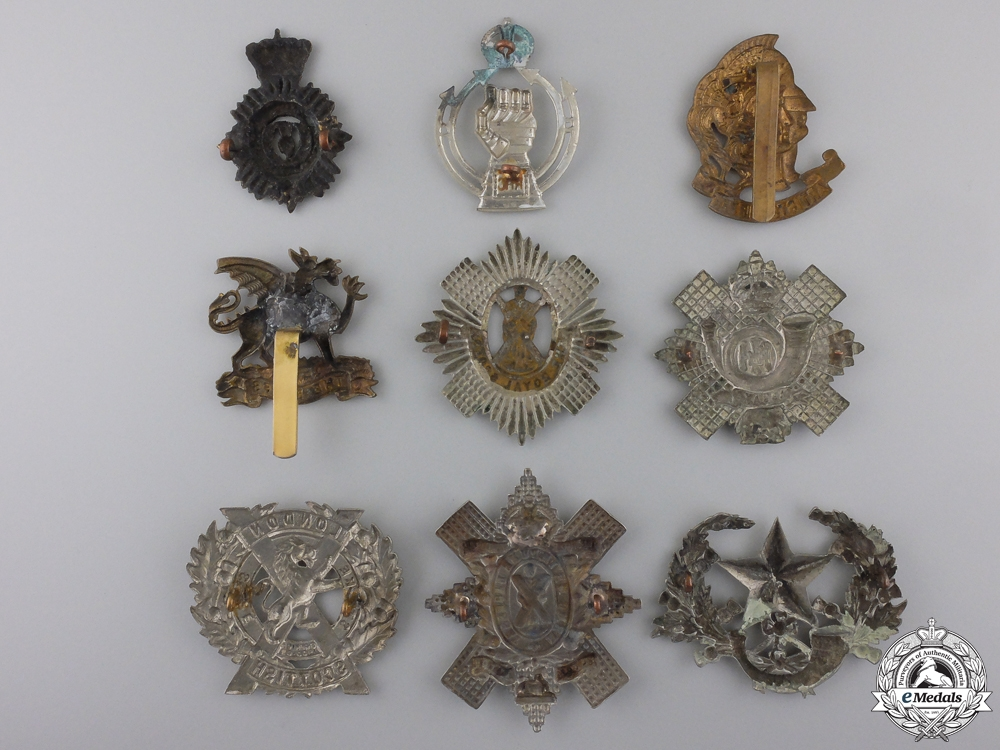 Nine First War British Cap Badges