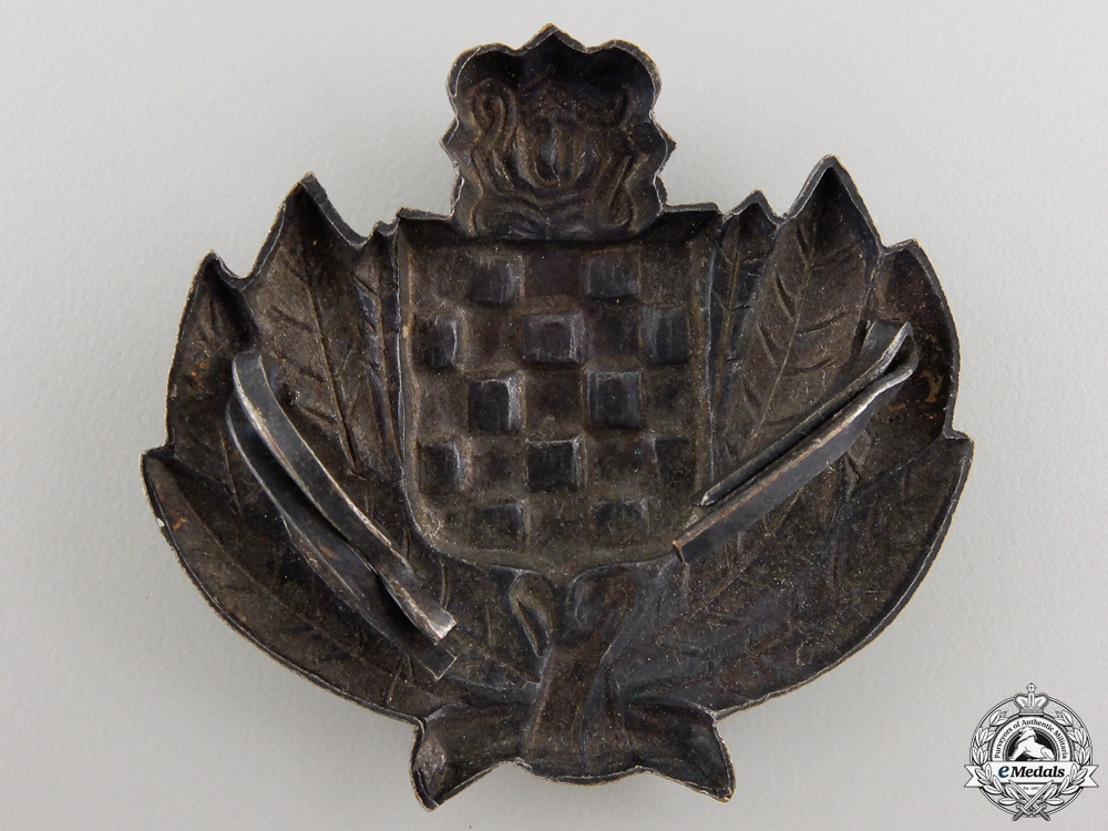 A Croatian Financial Police Cap Badge
