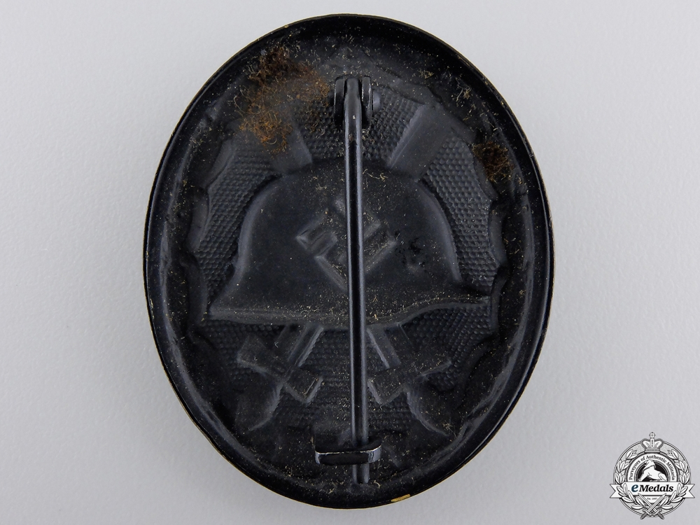 A Mint Black Grade Wound Badge