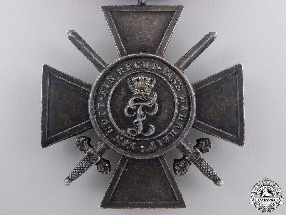 An Oldenburg War Merit Cross with Swords; Third Class