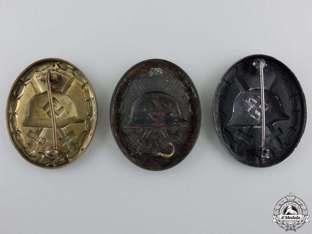 Three Second War Black Grade Wound Badges