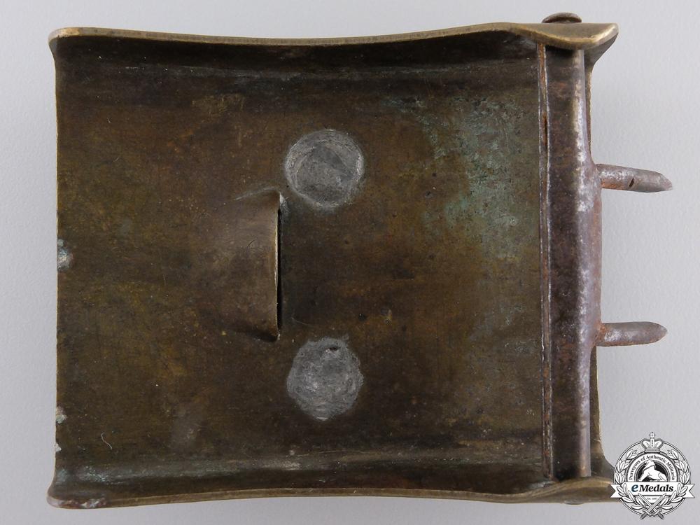 An SA EM/NCOS Belt Buckle