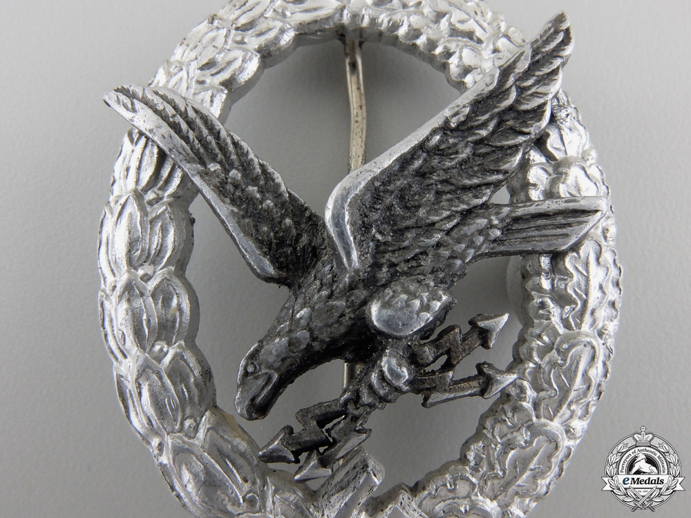 An Luftwaffe Radio Operator Badge in Aluminum by Assmann