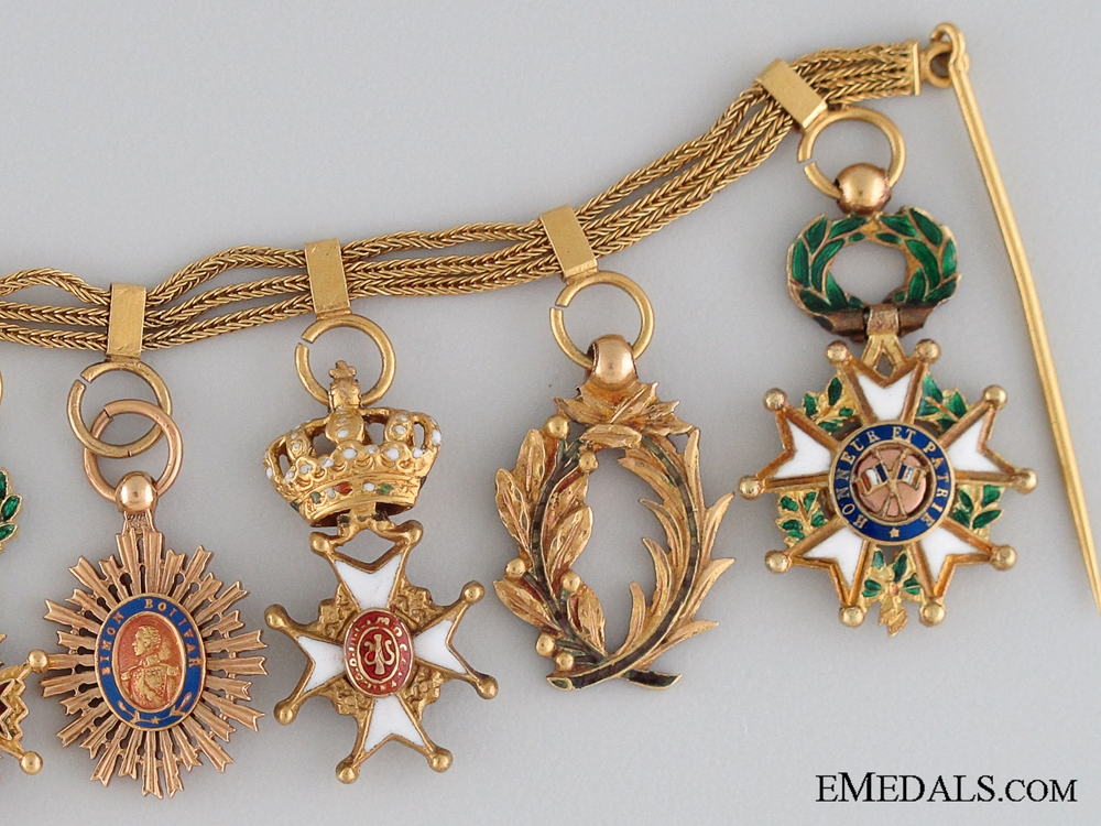 A Early 20th Century French Gold Miniature Group of Nine
