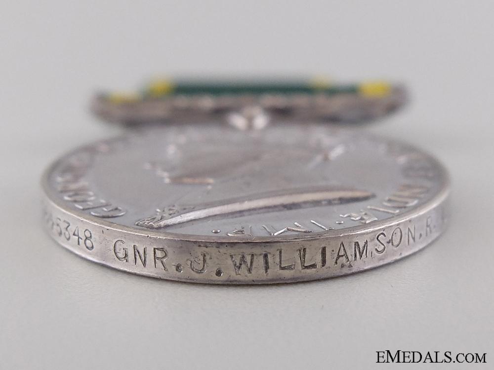 An Efficiency Medal to Gunner J. Williamson; Royal Artillery