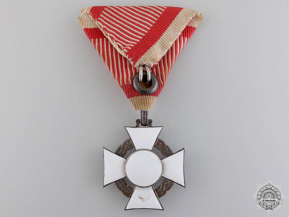 An Austrian Military Merit Cross with War Decoration by A.E. Köchert