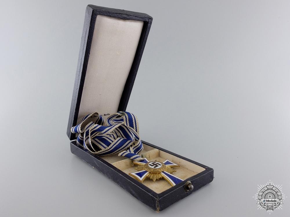 A Gold Grade Mother's Cross by C.E.Juncker