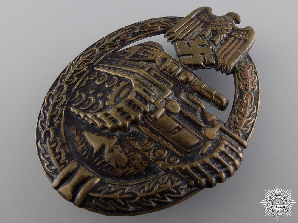 An Early Bronze Grade Tank Assault Badge by B.H. Mayer