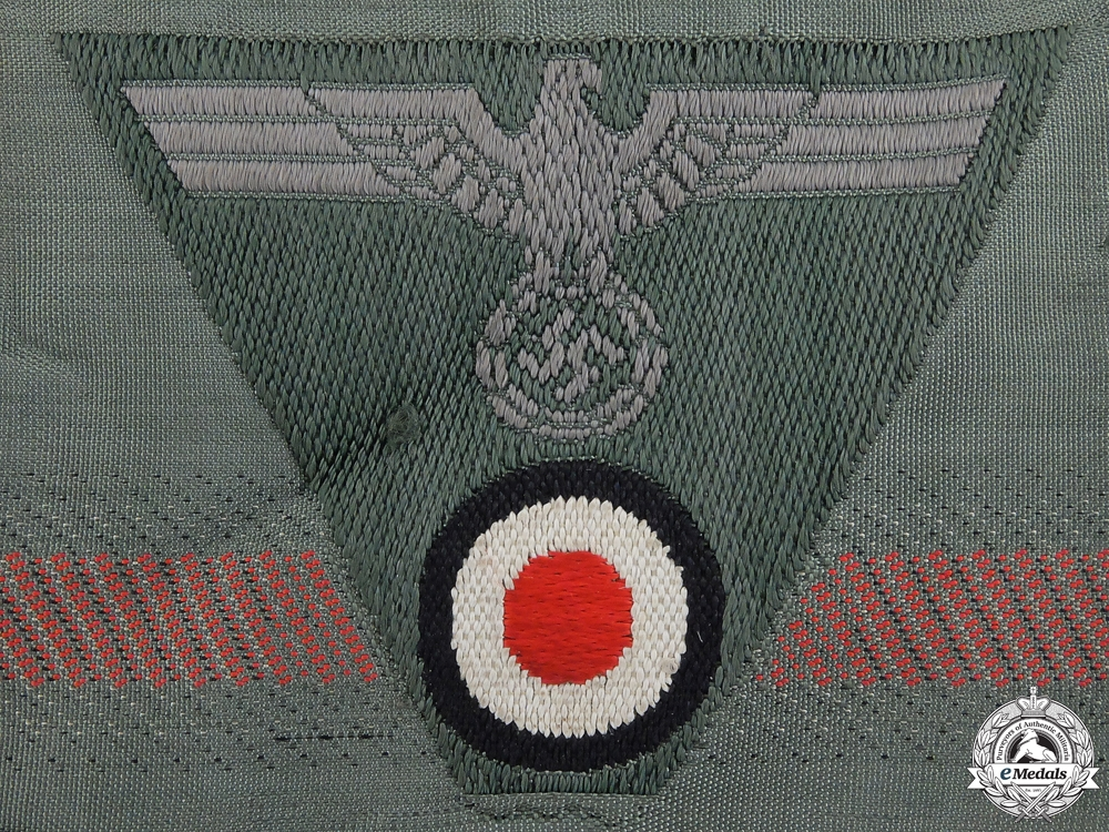 A Mint Strip of German M43 Trapezoid Cap Insignia