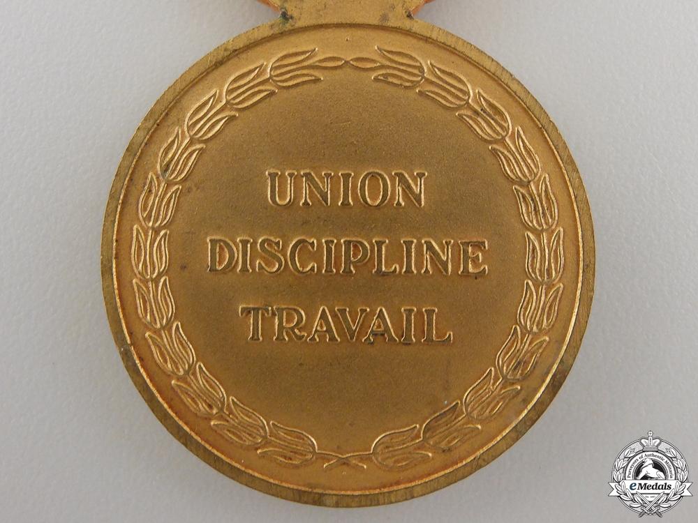 An Ivory Coast Medal of National Merit Medal; Gold Grade