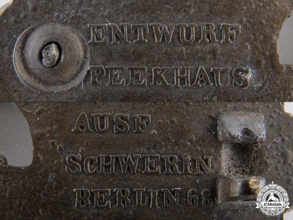 A Bronze Grade Kriegsmarine Submarine Clasp by Schwerin