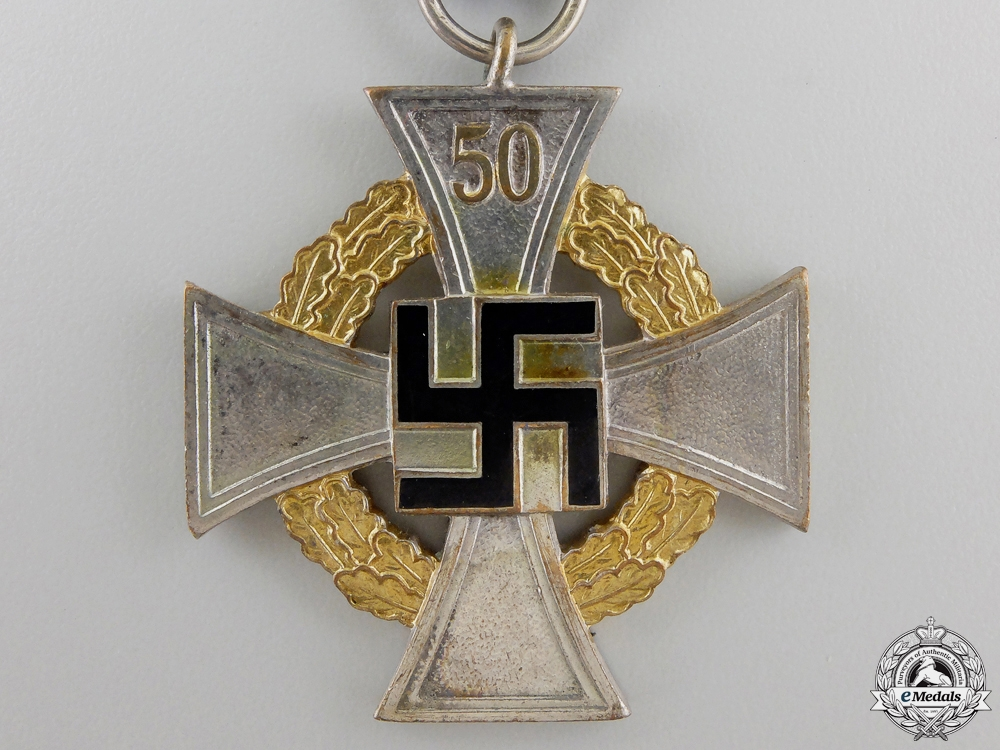 A German Faithful Service Cross; 1st Class with Miniature