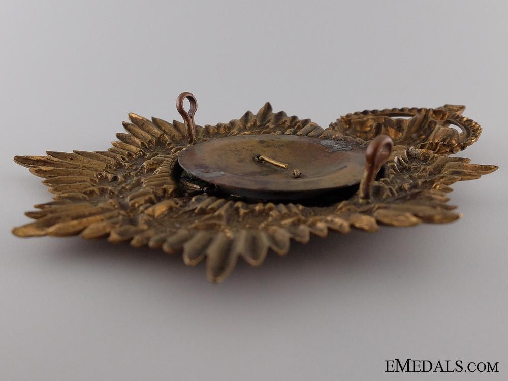 A 1904 13th Canadian Militia Helmet Plate
