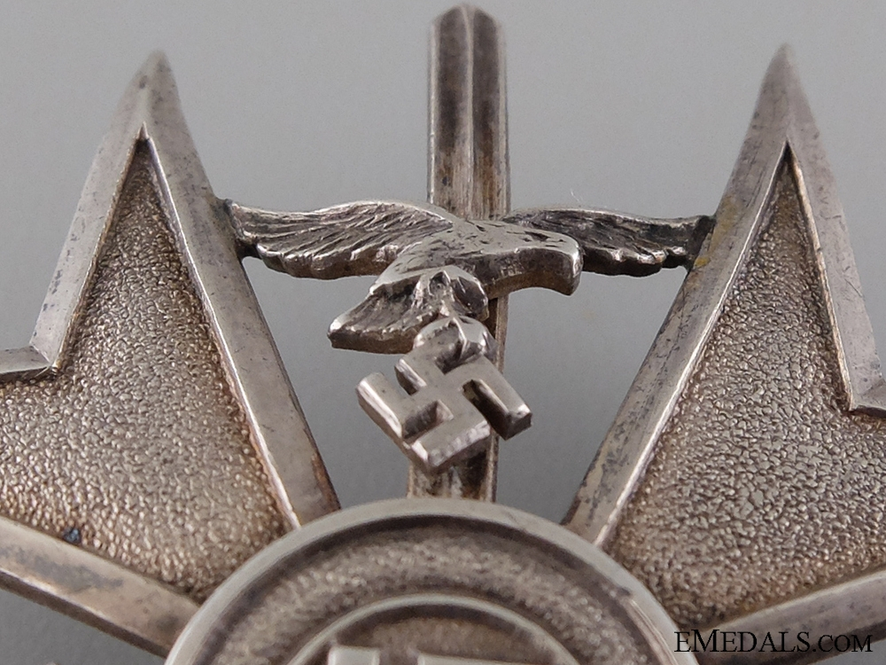 A Spanish Cross in Silver with Swords; Marked 835