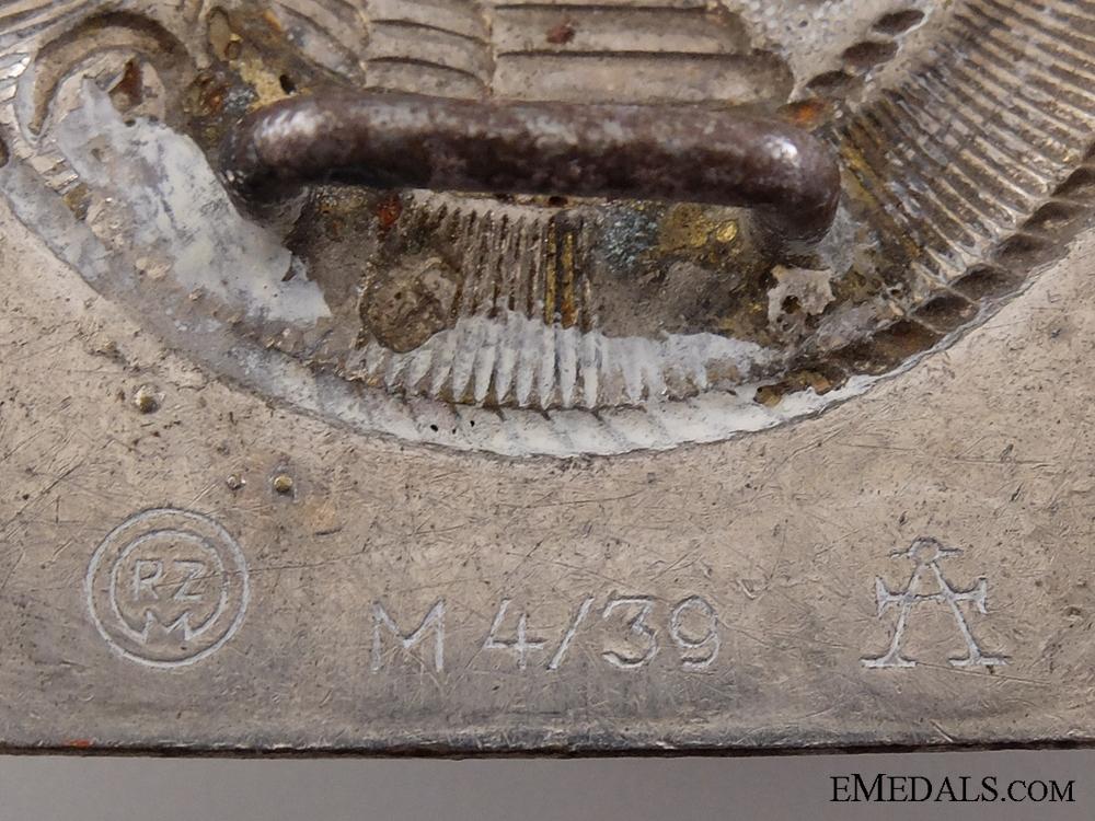 An HJ Belt Buckle by Assmann