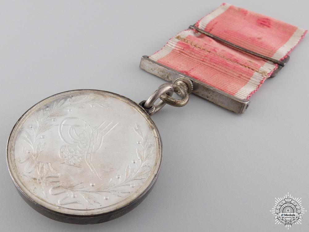 A Superb Turkish Medal of Acre for Junior Officer's 1840