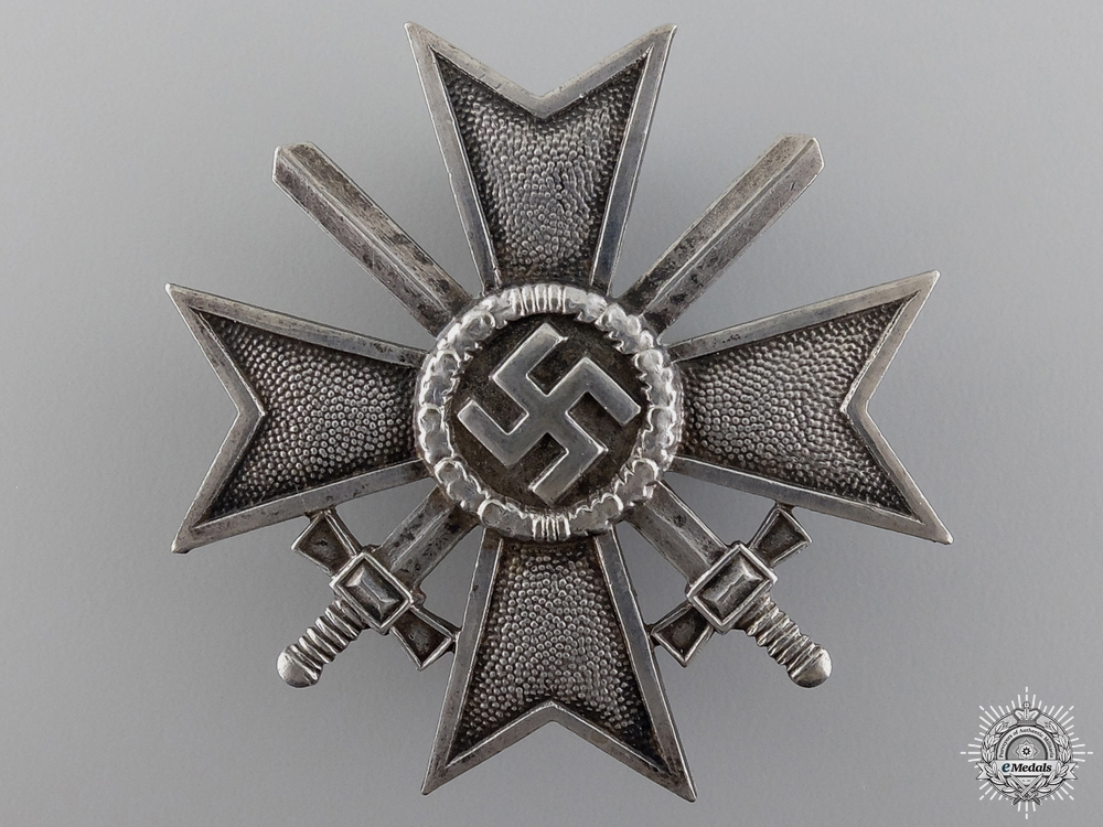 An Early Cased First Class War Merit Cross with Swords