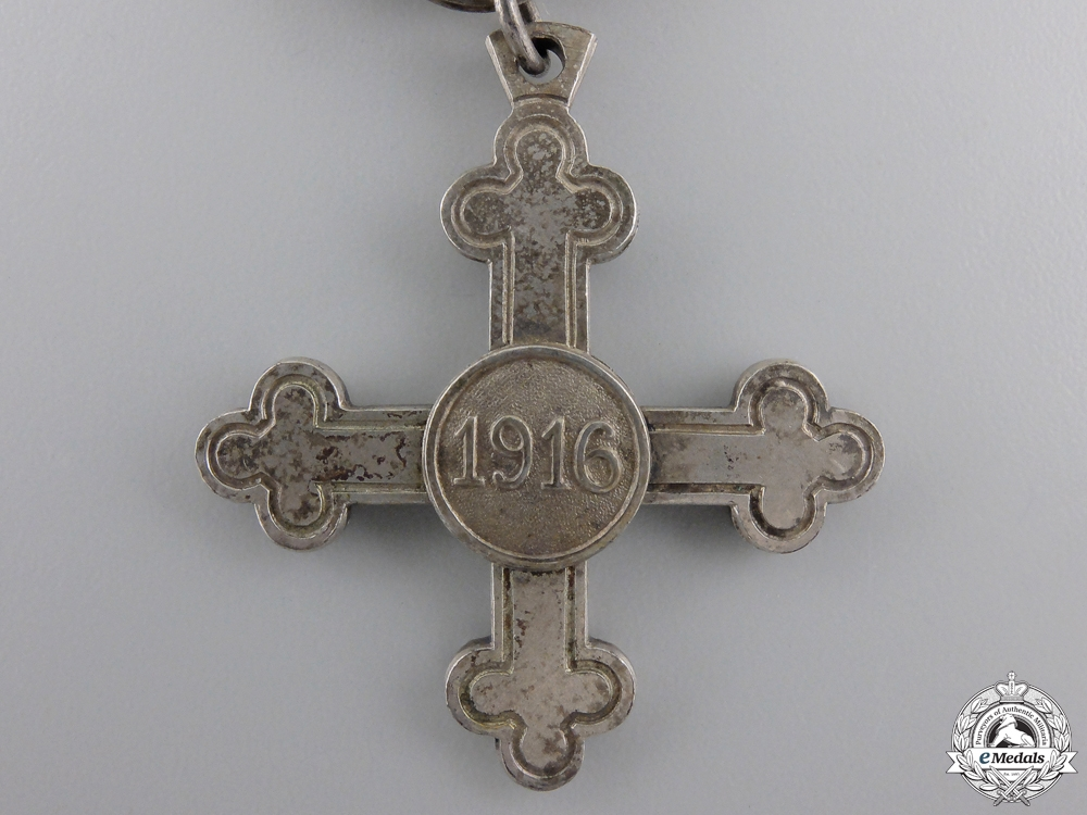 A 1916 Charlotte Cross 1916 & Miniature
