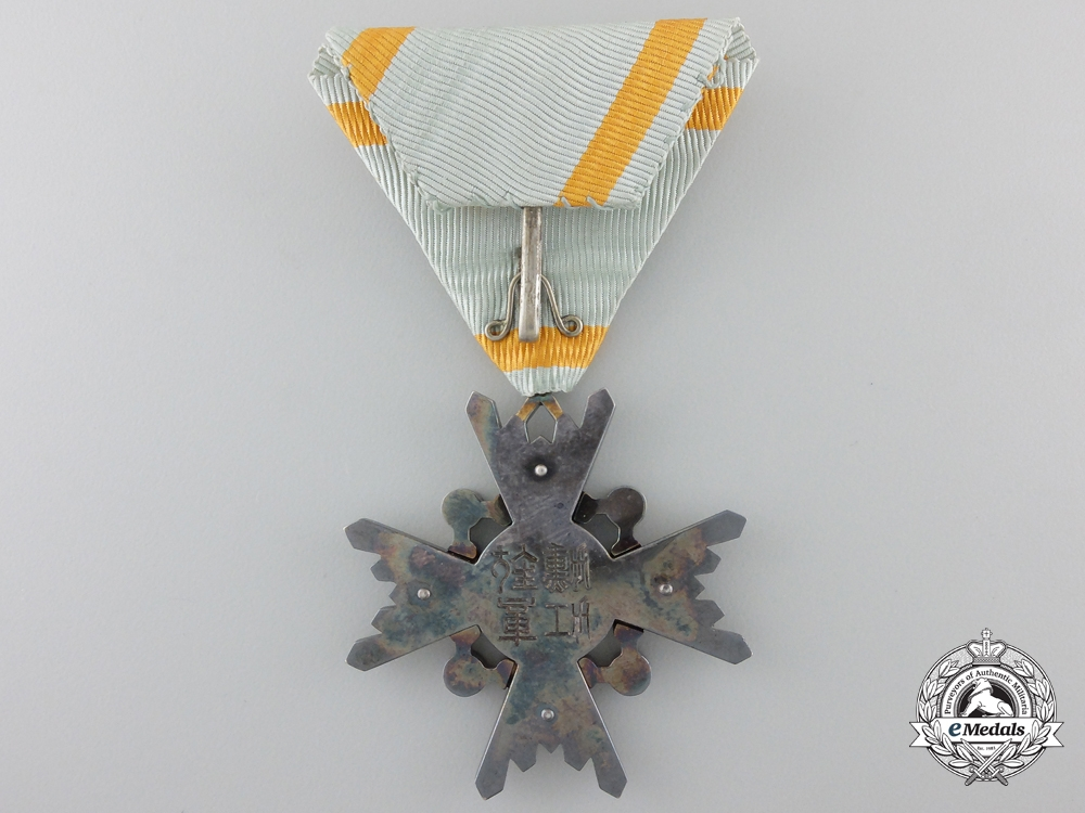 A Japanese Order of the Sacred Treasure with Packet of Issue