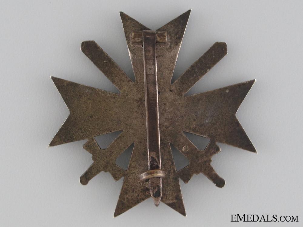 An Early War Merit Cross with Swords First class by Maker 43