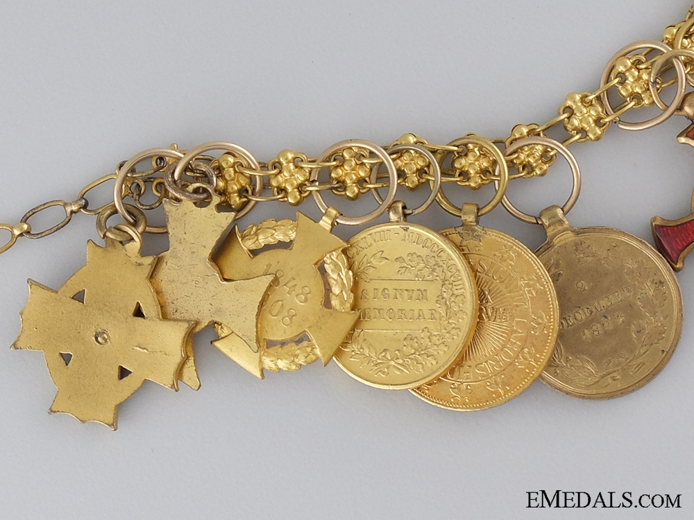 A Fine Set of 11 Miniatures on a Gold Chain 1900-1910