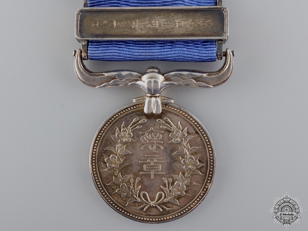 A Japanese Civic Merit Medal with Case; Named