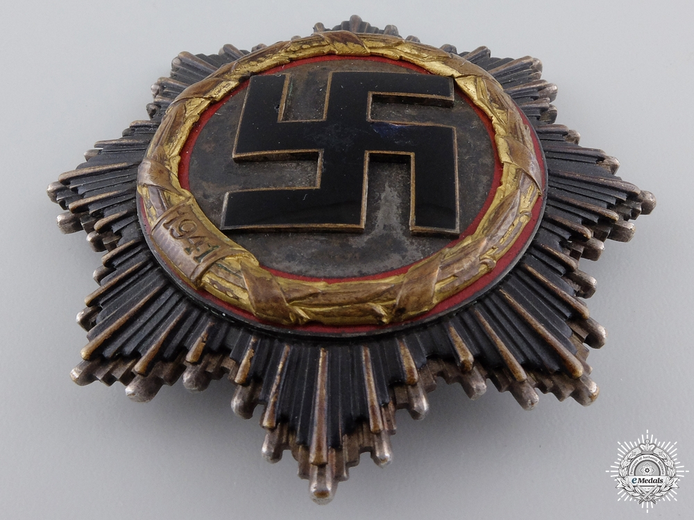 A German Cross in Gold by Deschler & Sohn to Stuka Pilot Karl-Hermann Lion